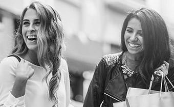 Black and white photo of women shopping