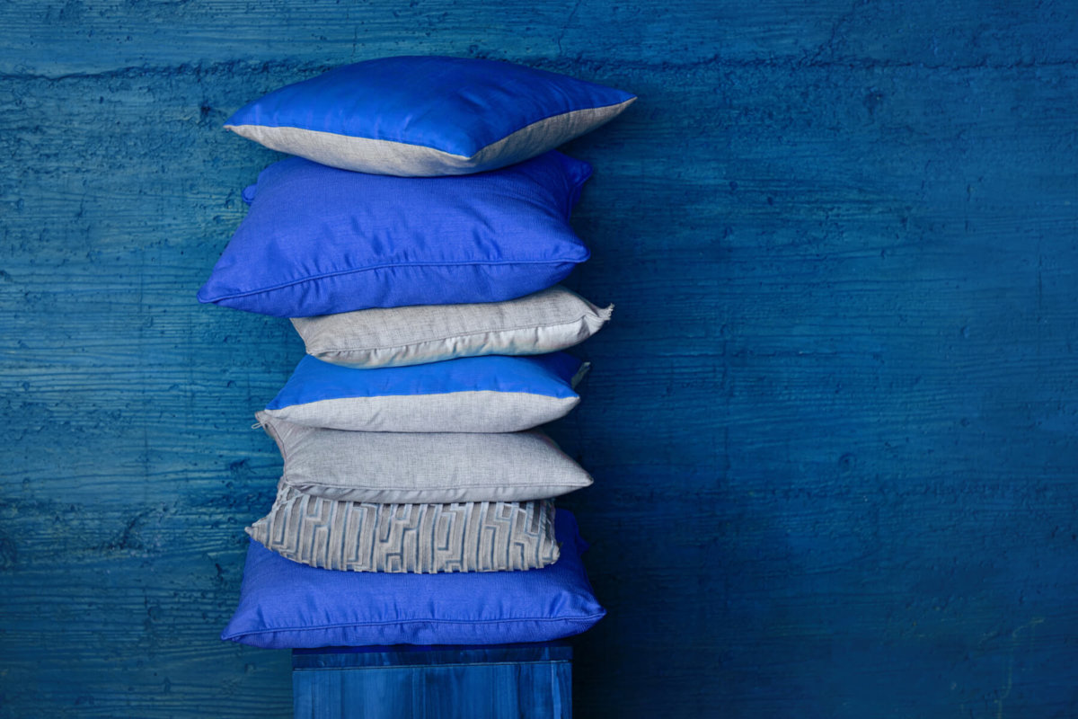 Stack of blue throw pillows