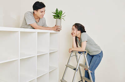 Couple decorating their apartment