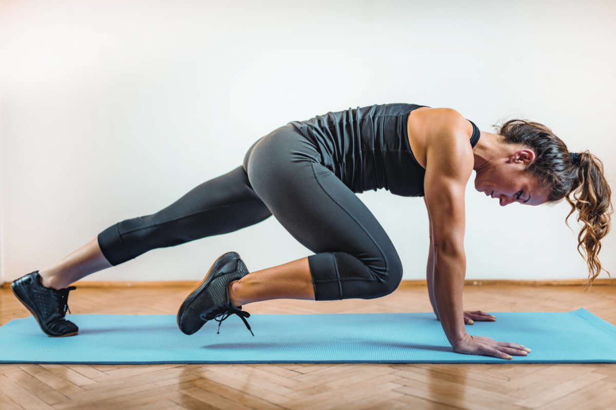 Woman doing high intensity interval training in her apartment