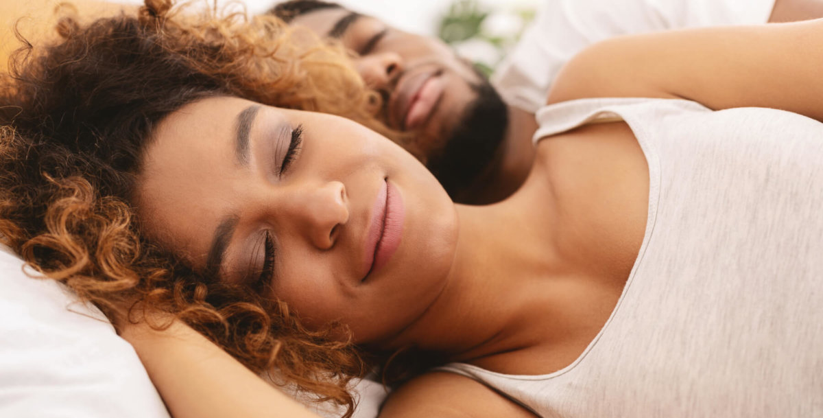 Man and woman in bed sleeping peacefully