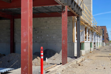 Close-up shot of future retail space in Building D, and a view looking north along S. Union Street.