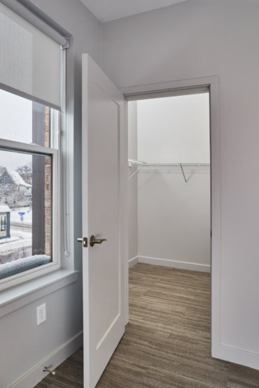 Spacious walk-in closet off the master bedroom in our 2-bedroom townhome.