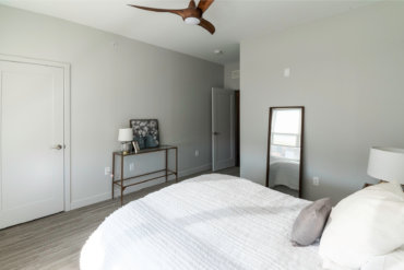Master bedroom in our 2-bedroom townhome, with a spacious walk-in closet and luxurious en suite bathroom.