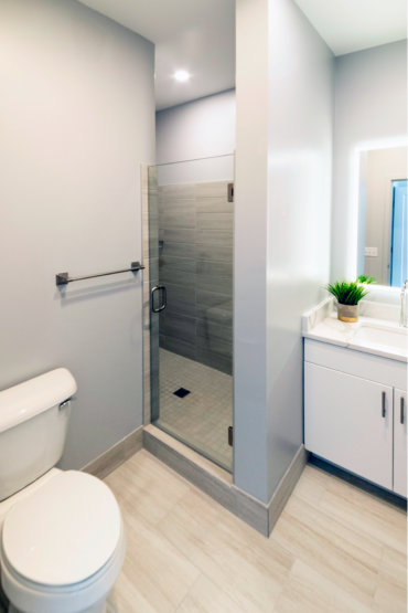 Master en suite bathroom in our 2-bedroom townhome, complete with tile shower and glass door.