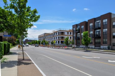 Looking south (toward Monroe Ave.) on S. Union Street. The completed building E is in the foreground. Building D, which is under construction, is in the background.