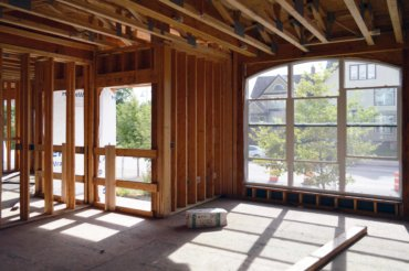 Large windows in a first-floor townhouse (unit T1A) will provide beautiful views from Building D.