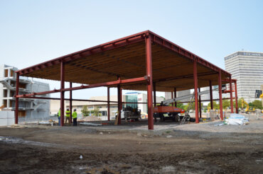 Work on building C continues, where retail space will be housed.