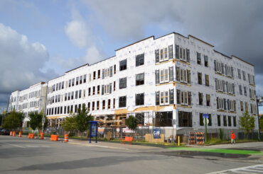 A view of Building D progress at the corner of South Union Street and Savannah Street.
