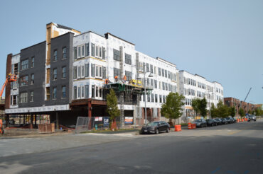 Construction continues with a view of the southeast side of Building D from South Union Street.