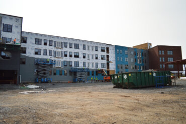 Exterior work continues with a view of the back of Building D.