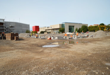 Workers begin to lay the foundation for Building B; the fourth of five buildings to be built at VIDA.
