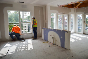Workers take advantage of the natural light inside unit 2D in Building D.