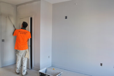 Painting the walls in a two-bedroom apartment (2-A) in Building D.