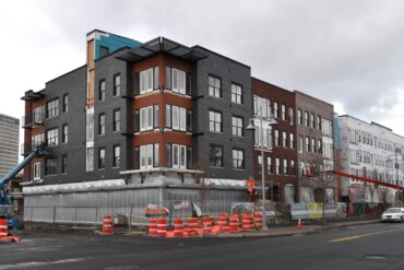 A view of Building D along S. Union St. The area on the first floor that is wrapped will be retail space