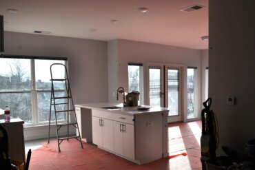 The kitchen, living room and balcony doors in unit 2A; a two bedroom, two bathroom apartment.