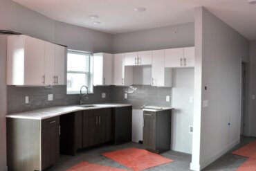 The kitchen of unit 1D; a one bedroom two bathroom apartment.