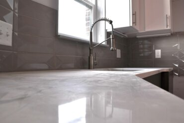 Kitchen counter and faucet in unit 1D.