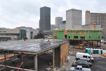 A view looking down on early construction of Building C (foreground) and Building B (background).