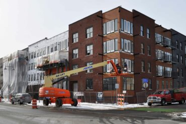 Building D along South Union Street at the corner of what will be Inigo Road.