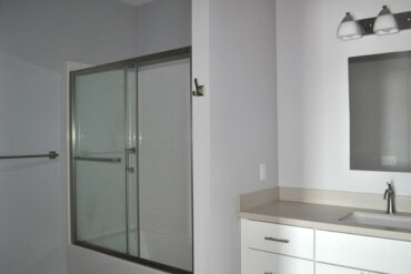 Work is complete on this bathroom of a one-bedroom apartment (Unit 1C).
