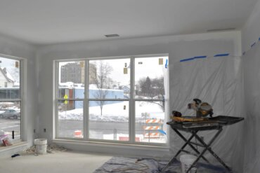 A view from the living room of a 2E corner unit looking onto South Union Street.