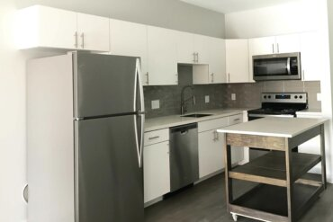 The appliances and mobile island are in place in this kitchen (unit 1C).