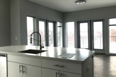 Work is complete on this stunning corner apartment (Unit 2A), which features two sets of double doors leading to the wrap-around balcony.