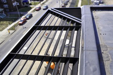 Looking down on South Union Street from what will be the rooftop deck of Building D.