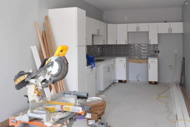The cabinets have been installed in the kitchen of this one-bedroom townhouse (unit T1A).
