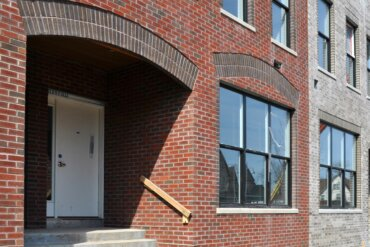 The exterior of Building D features some beautiful brick work, especially the arched lintels over the doorways.