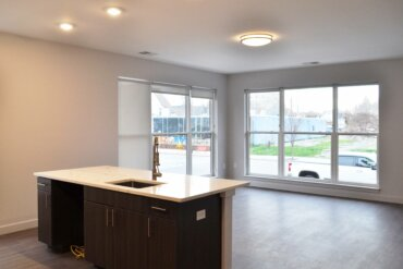Window treatments and finish work are almost complete in this corner unit (2D). It features an open kitchen and living area with a great view of South Union Street.