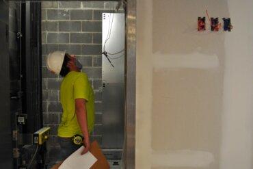 Elevator installation is in progress in Building D.