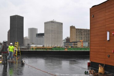 It may have been a rainy day, but work continues on the rooftop deck of Building D.