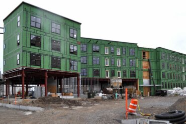 Most of the windows and exterior insulation are in place on Building B.