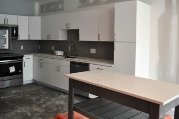The kitchen cabinets and appliances have been installed in Unit 2B - a one-bedroom, one-bath apartment in Building D.