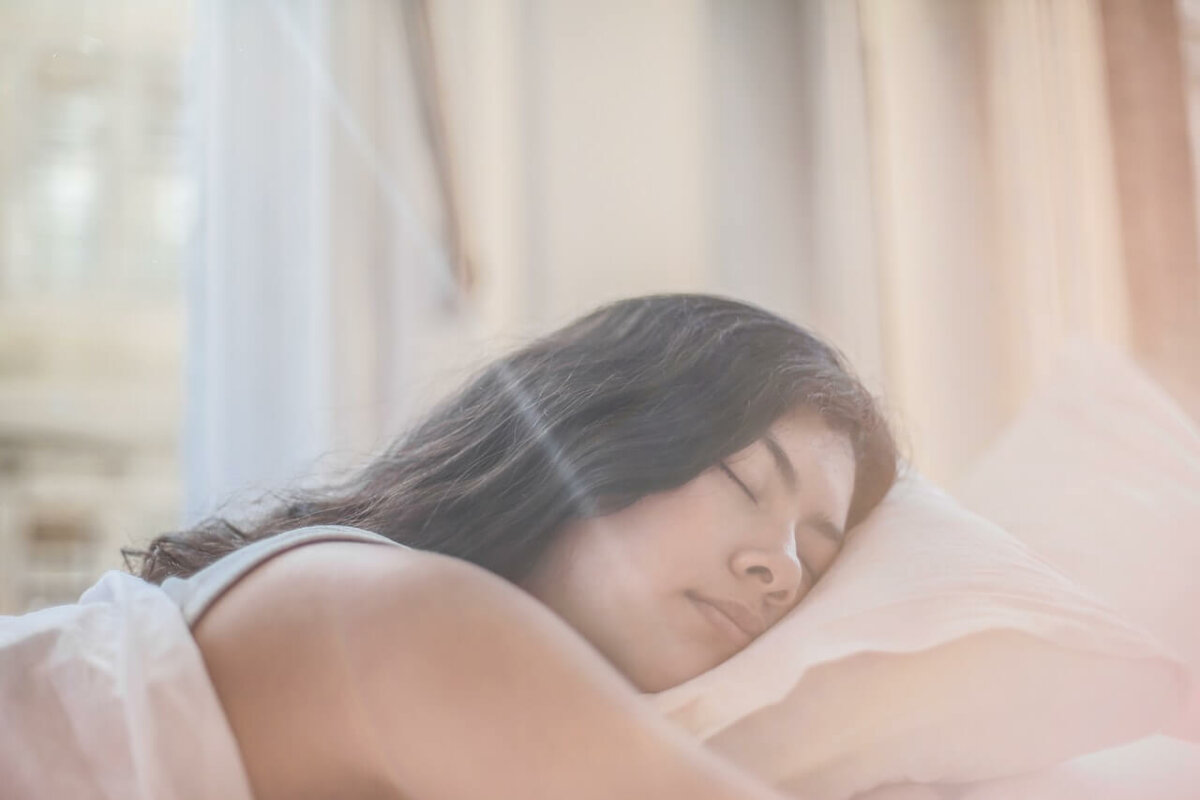 Woman sleeping in bed. Image credit: Andrea Piacquadio
