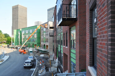 An exterior view of Buildings A and B along Adventure Way - taken from a balcony in Building B.