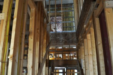 A view look up what will be the stairway in townhome in Building A