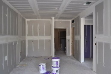 Drywall work in progress in a Studio B apartment in Building A