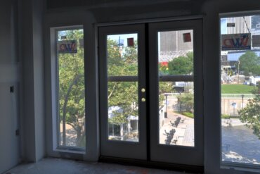 A view of MLK Park and the fountain from the balcony doors of a 1-bedroom apartment (unit 1-C) in Building B.