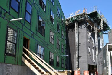 Exterior work continues on Building A, which is directly across the street from the Strong National Museum of Play