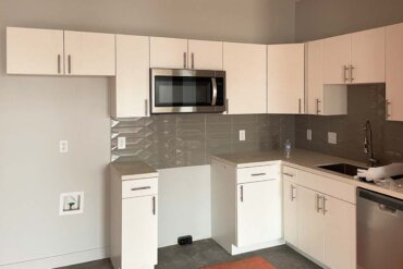 Appliances are being installed in the kitchen of this 2-bedroom, 2-bathroom apartment (Unit 2C) in Building B.