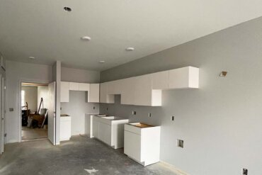The kitchen cabinets have been installed in this 1-bedroom, 1-bathroom apartment (Unit 1C) in Building B.