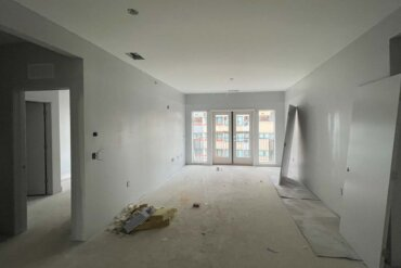 Doors are being hung in this 2-bedroom, 2-bathroom apartment (Unit 2C) in Building A.